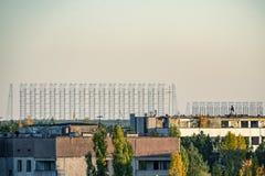 radar antenna visible on the horizon stock photo