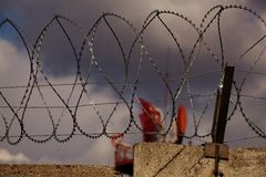Radar behind barbed wire Royalty Free Stock Image
