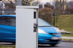 Radar box for speed control. The speed of a car on a road controlled by radar. rader box as a radar trap stock photo