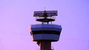 Radar communications tower plane. Dusk time stock video