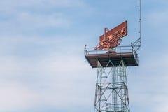 The radar rotates on the tower. Stock Photos