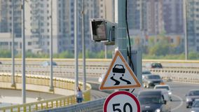 Radar speed control camera and signs on the road.  stock video footage