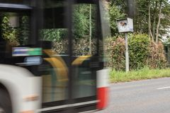 Radar speed trap with bus in motion. Radar speed trap with car in motion, only part of the car is visible royalty free stock photography