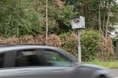 Radar speed trap with car in motion. Only part of the car is visible royalty free stock photography