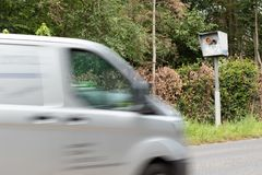 Radar speed trap with van in motion. Only part of the car is visible stock images