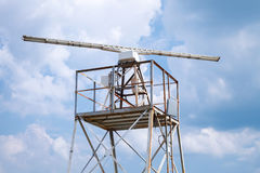Radar station tower above blue sky Royalty Free Stock Images