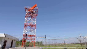 Radar tower at airport. Red and white metal radar tower in airport area stock video