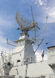 Radar tower on a destroyer. Radar tower on a modern destroyer against blue sky Royalty Free Stock Photo