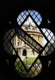Radcliffe camera through window of st. Mary in Oxford Stock Photos