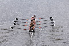 Radcliffe Women's Crew races in the Head of Charles Regatta Women's Master Eights Royalty Free Stock Photo
