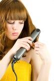 Raddrizzatore usando biondo dei capelli Fotografia Stock