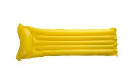 Radeau de flottement jaune de piscine Photographie stock libre de droits