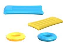 Radeaux gonflables et anneaux de bain d'isolement sur le blanc Photo libre de droits