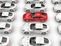 Rader av härliga sportbilar - den röda bilen står ut Arkivfoto