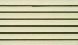 Rader av ljus - grön vinylsiding Arkivfoton