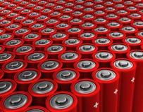 Rader av röda batterier Arkivbild