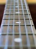rader för gitarrmusikhals Arkivfoto