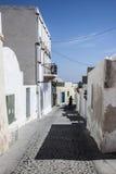 Radfahrer in Megalochori, Santorini Stockfotos