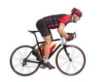 Radfahrer sprintet auf einem Fahrrad Stockfotos