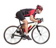 Radfahrer sprintet auf einem Fahrrad stockbilder