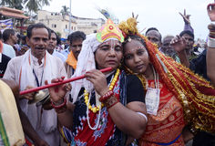 Radha Krishna at Car Festival. Two women devotees dressed like Radha and Krishna at Ratha Yatra ( Car Festival) to worship Lord Jagannath Royalty Free Stock Photo