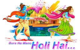 Radha och Lord Krishna som leker Holi Royaltyfri Foto