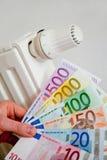 Radiador con el dinero Foto de archivo libre de regalías