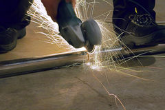 Radial arm saw. Working casting a stream of sparks stock photo