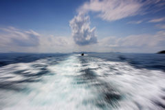 Radial motion blur / zooming effect  about the sea in a clear sk Stock Images