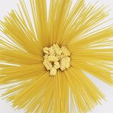 Radial spaghetti and radiatori. Lots of radiant spaghetti and some radiatori noodles in light grey back Royalty Free Stock Photo