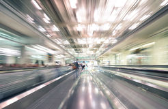 Radial zoom defocused treadmills with motion blur at airport Stock Images