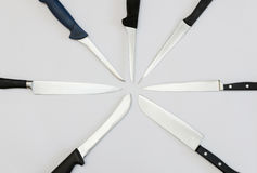 Radially arranged kitchen knives Royalty Free Stock Photography