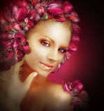 Radiance. Beautiful Golden Girl With Purple Tulips Flowers Stock Photography