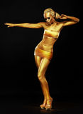 Radiance. Fantasy. Golden Woman Performing in Night Club. Lights Royalty Free Stock Image