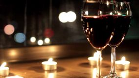 The radiance reflected in glasses with wine during a romantic evening stock video footage