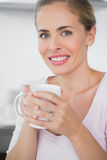 Radiant blonde woman drinking coffee Royalty Free Stock Photography