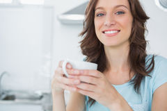 Radiant brunette drinking coffee Royalty Free Stock Photo