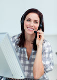 Radiant businesswoman with headset on Royalty Free Stock Images