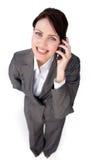 Radiant businesswoman on phone Stock Image