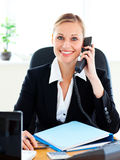 Radiant businesswoman phoning in her office Royalty Free Stock Image