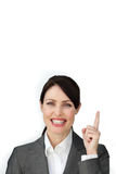 Radiant businesswoman pointing up Stock Images