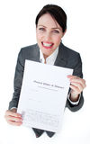 Radiant businesswoman showing a legal document Stock Photos