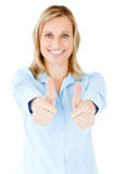 Radiant businesswoman smiling with thumbs up Stock Photography