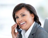 Radiant businesswoman talking on phone Stock Images