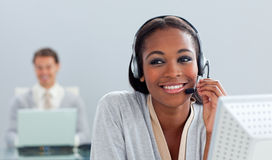 Radiant businesswoman using headset at her desk Royalty Free Stock Photography
