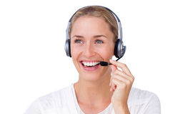 Radiant busineswoman talking on a headset. Against a white background Stock Photography
