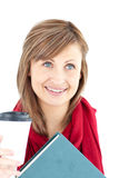 Radiant caucasian woman holding a book and coffee Royalty Free Stock Photos