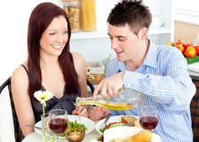 Radiant couple dining together in the kitchen Stock Images