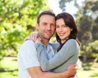 Radiant couple hugging in the park Stock Image