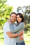Radiant couple hugging in the park Stock Photography